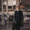 Roger Moore as James Bond Agent 007 walking through the Pan Am Worldport in 1973's Live and Let Die.